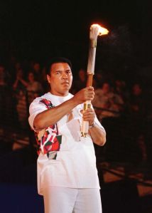 Muhammad-Ali-lighting-Olympic-Torch-in-1996