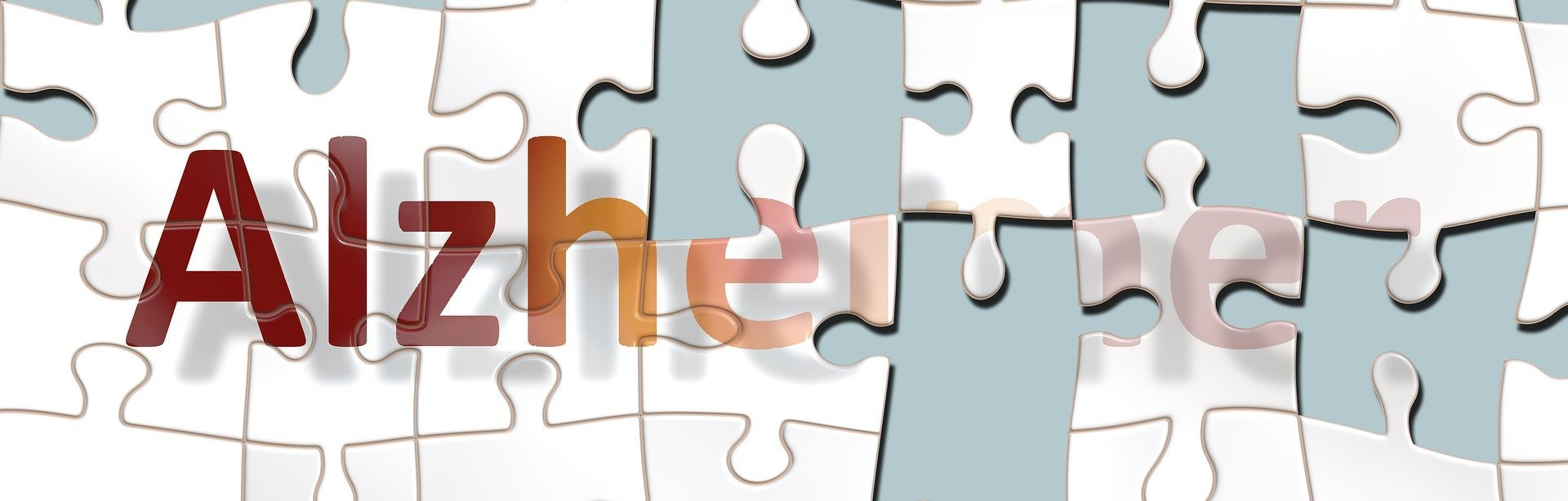 Puzzle with the Alzheimer on it and missing pieces