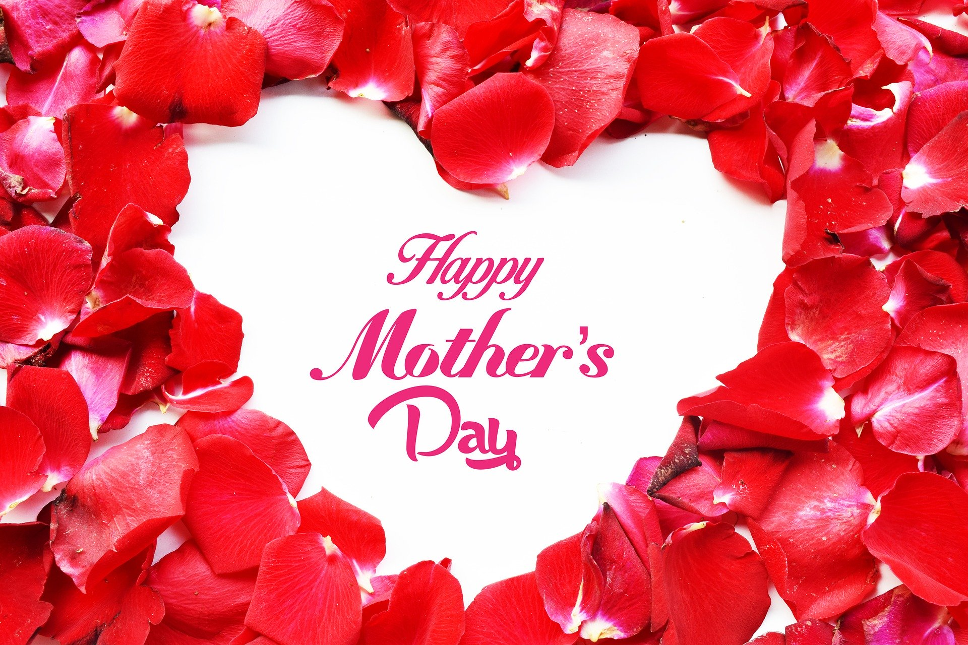 Happy Mother's Day text framed by red rose petals in an heart shape